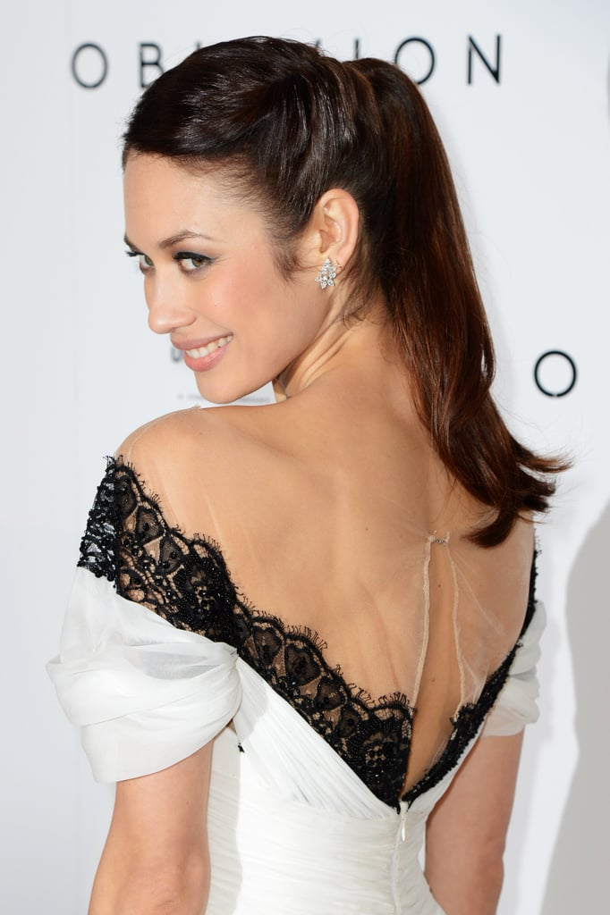 Olga Kurylenko upgraded her up 'do with twists on each side for the Oblivion red carpet.
