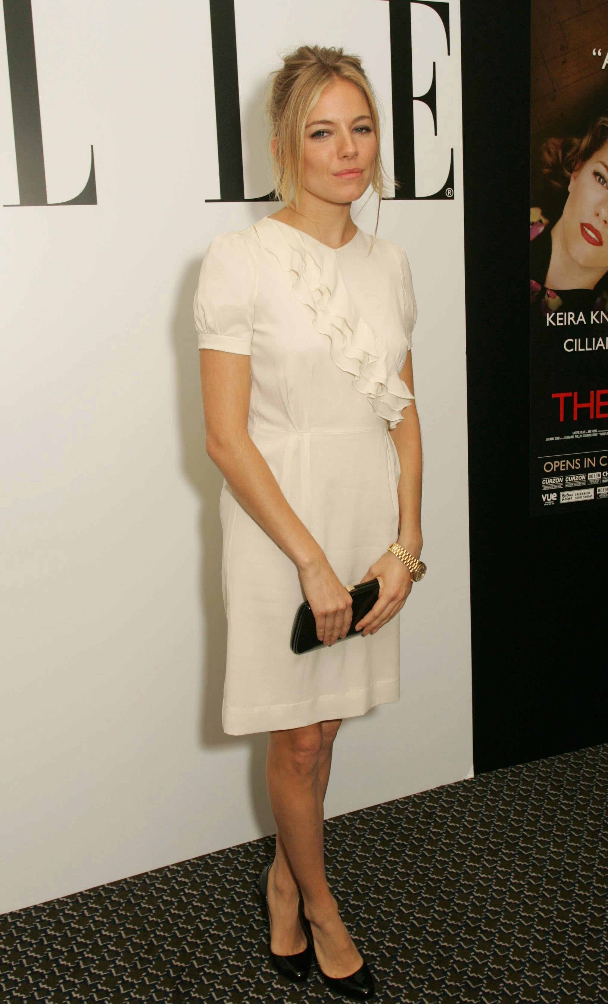 Sienna looked chic and ladylike in white in 2008.