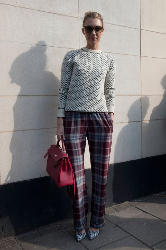 A preppy-meets-chic play on plaid pants and a textured knit.