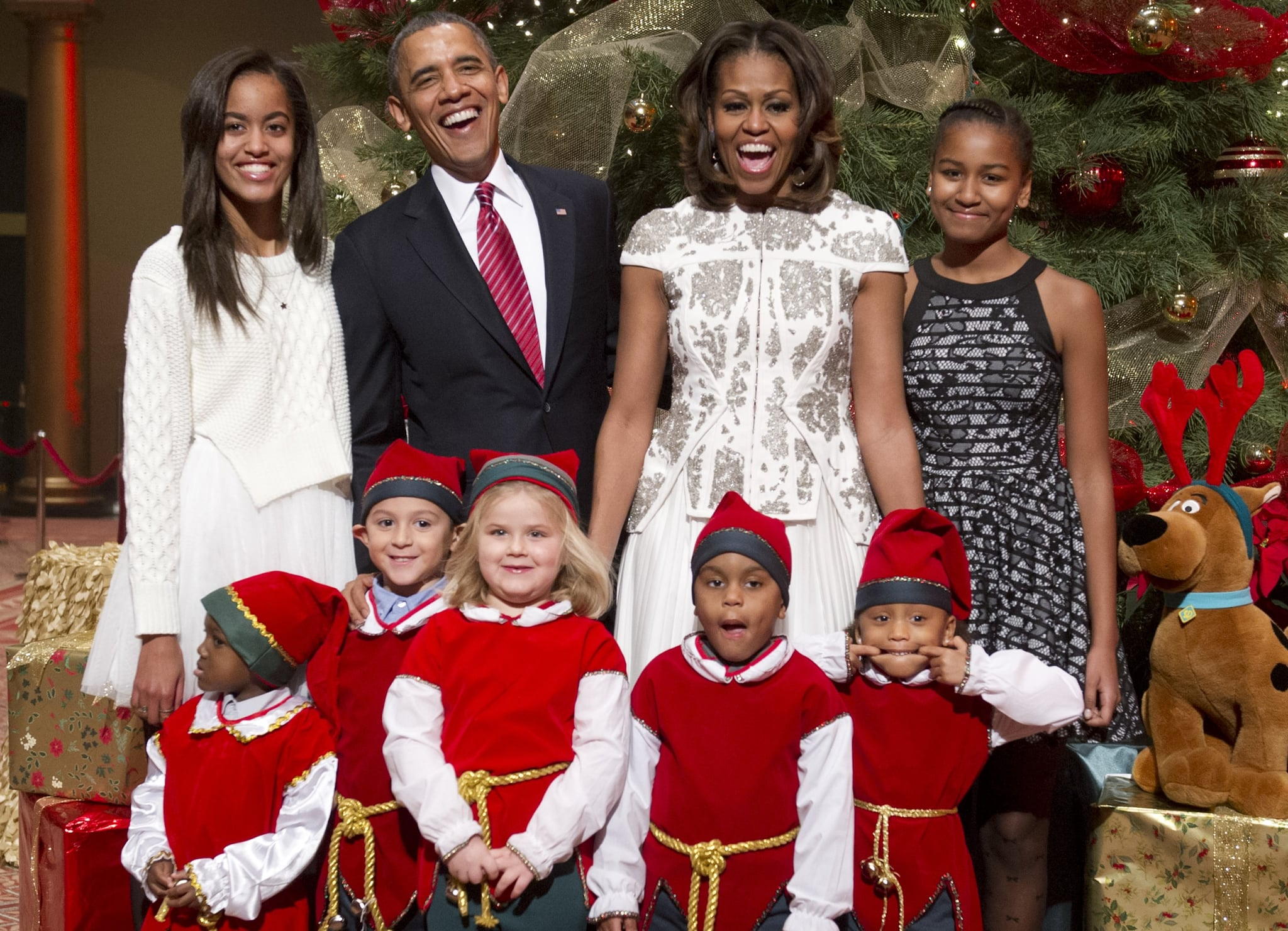 President Barack Obama and First Lady Michelle Obama had a laugh with their family while hanging out with children dressed up as elves during a taping of TNT's Christmas in Washington special.