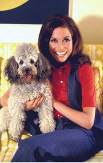 Ever the animal lover, Mary poses with her dog at home in 1970.