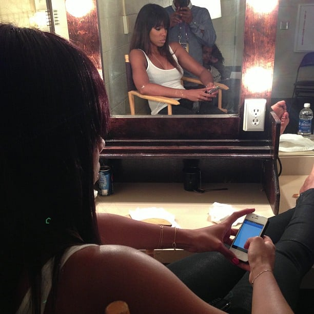 Kelly Rowland checked out her phone while waiting in her dressing room at the Super Bowl. Source: Instagram user 1774inc