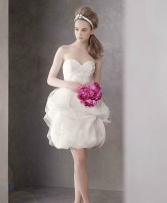 Channel the girlie bridal factor with a flirty party dress you can move in. This one is glamorous enough for even your black-tie wedding parties.  White by Vera Wang Short Satin-Faced Organza Dress With Tulle Overlay ($528)