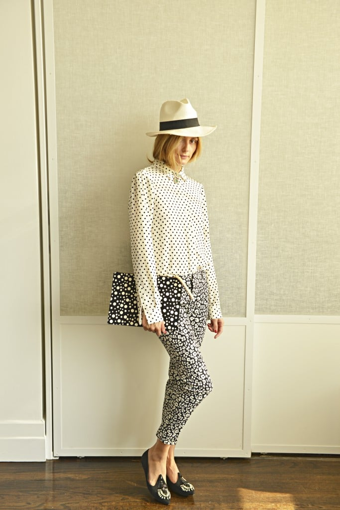 We've seen Olivia wear these Banana Republic pants before — and we'll never tire of the way she repurposes her wardrobe. If you thought you had to temper pants like this with a solid blouse, Olivia dared you to go bolder with an equally eye-catching print up top, albeit in the same color scheme. A black-and-white palette keeps the look cohesive, even on her dotted Sass & Bide clutch.  Source: Olivia Palermo