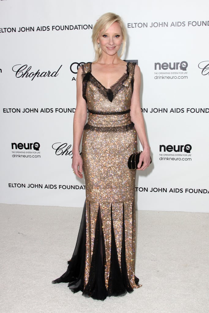 Anne Heche went glittery in a gold and black sheer-trimmed gown by Dolce and Gabbana.