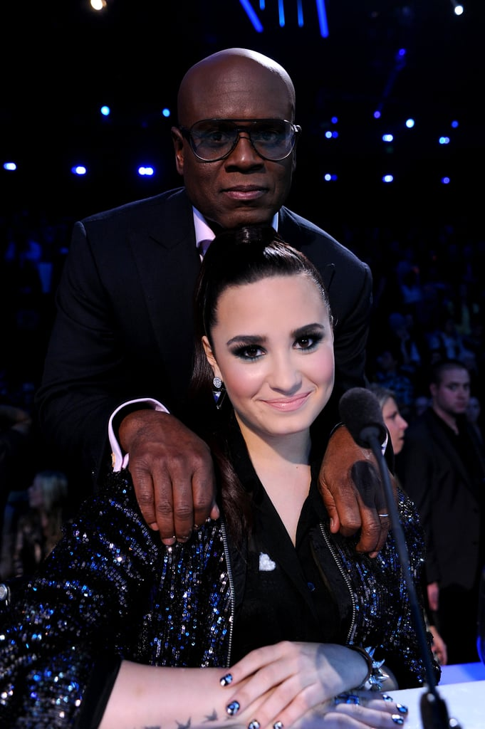 L.A. Reid and Demi Lovato took a break from filming the semifinals.