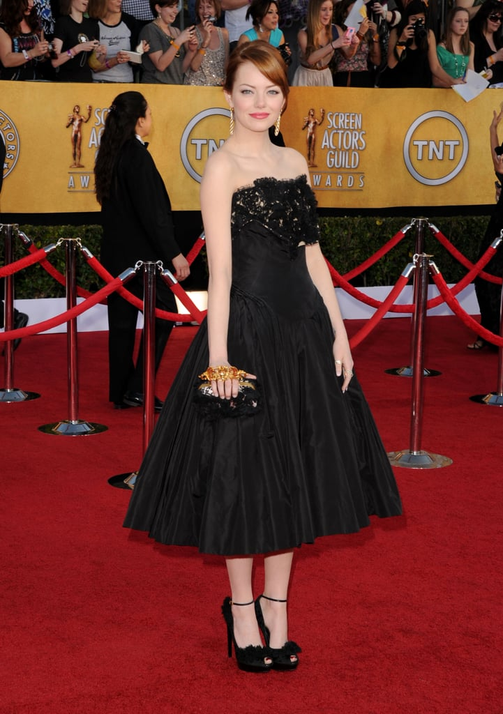 Emma Stone wore a black, lacy Alexander McQueen.