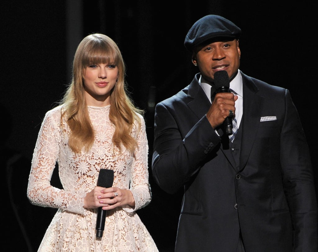 Taylor Swift wore a white lace dress on stage at the Grammy Nominations show.
