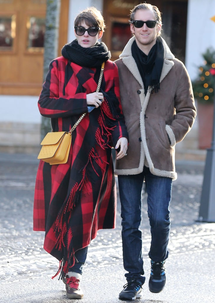 Anne Hathaway added a clever pop of yellow to her tartan plaid coat while vacationing with her new husband.