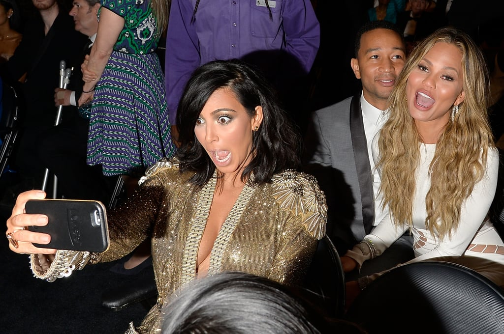 The undisputed Queen of selfies, Kim Kardashian, nails a photo with a friendly photobomb from John Legend and Chrissy Teigen during the Grammy Awards in February 2015.