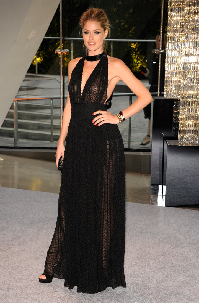 Doutzen Kroes opted for a low-cut black Swiss-dot gown and gold jewelry.