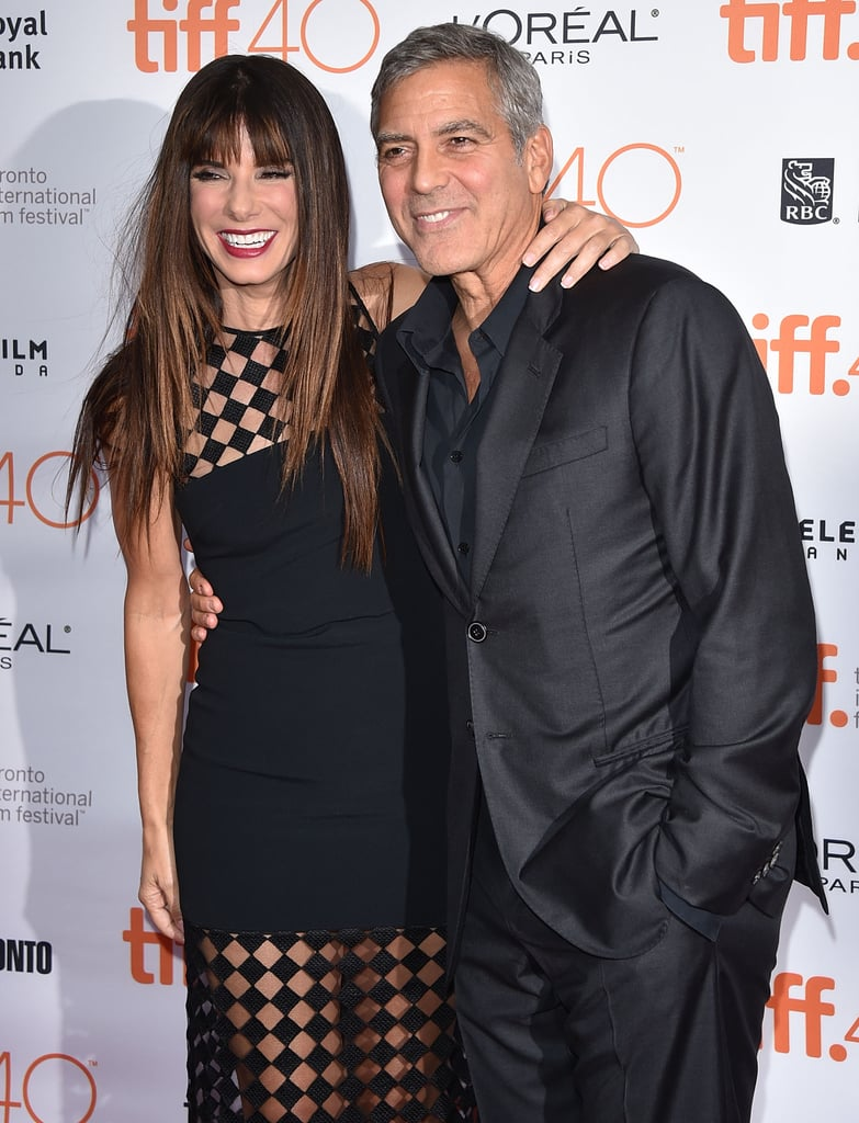 Sandra was all smiles with George Clooney at a Toronto photo call for their film Our Brand Is Crisis ins September 2015.