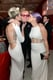Mily Cyrus and Kelly Osbourne kissed Elton John on the cheek at his Oscar viewing party.