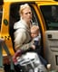January Jones carried baby Xander out of a cab in NYC.