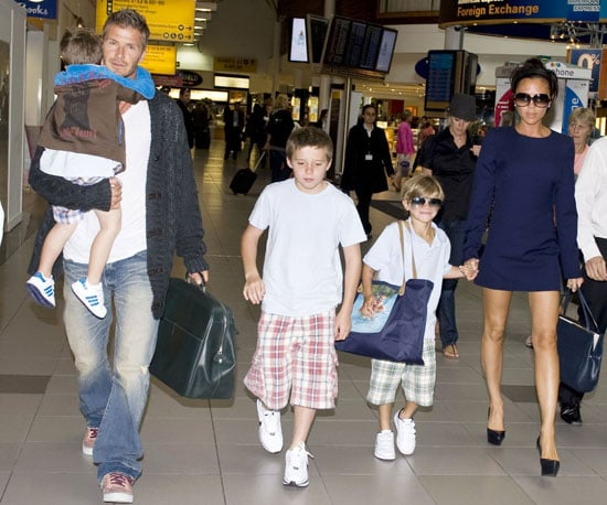 Photo Slide of David and Victoria Beckham with Their Sons Romeo, Cruz and Brooklyn in London at Heathrow