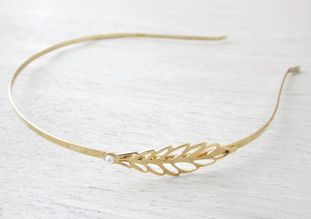 If you want an understated accessory, try this hollow-leaf headband ($36) for a hint of glitz.
