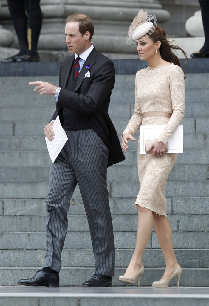 Kate's soft, creamy lace dress complemented Prince William's gray and black suit.