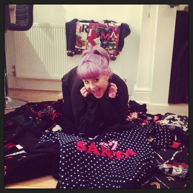 "Kelly Osbourne posed with festive Christmas sweaters, saying her best friend is making her wear ""one of these glorious masterpieces!"" Source: Instagram user kellyosbourne"