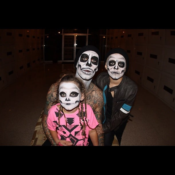 Travis Barker dressed as a skeleton with his kids. Source: Instagram user travisbarker