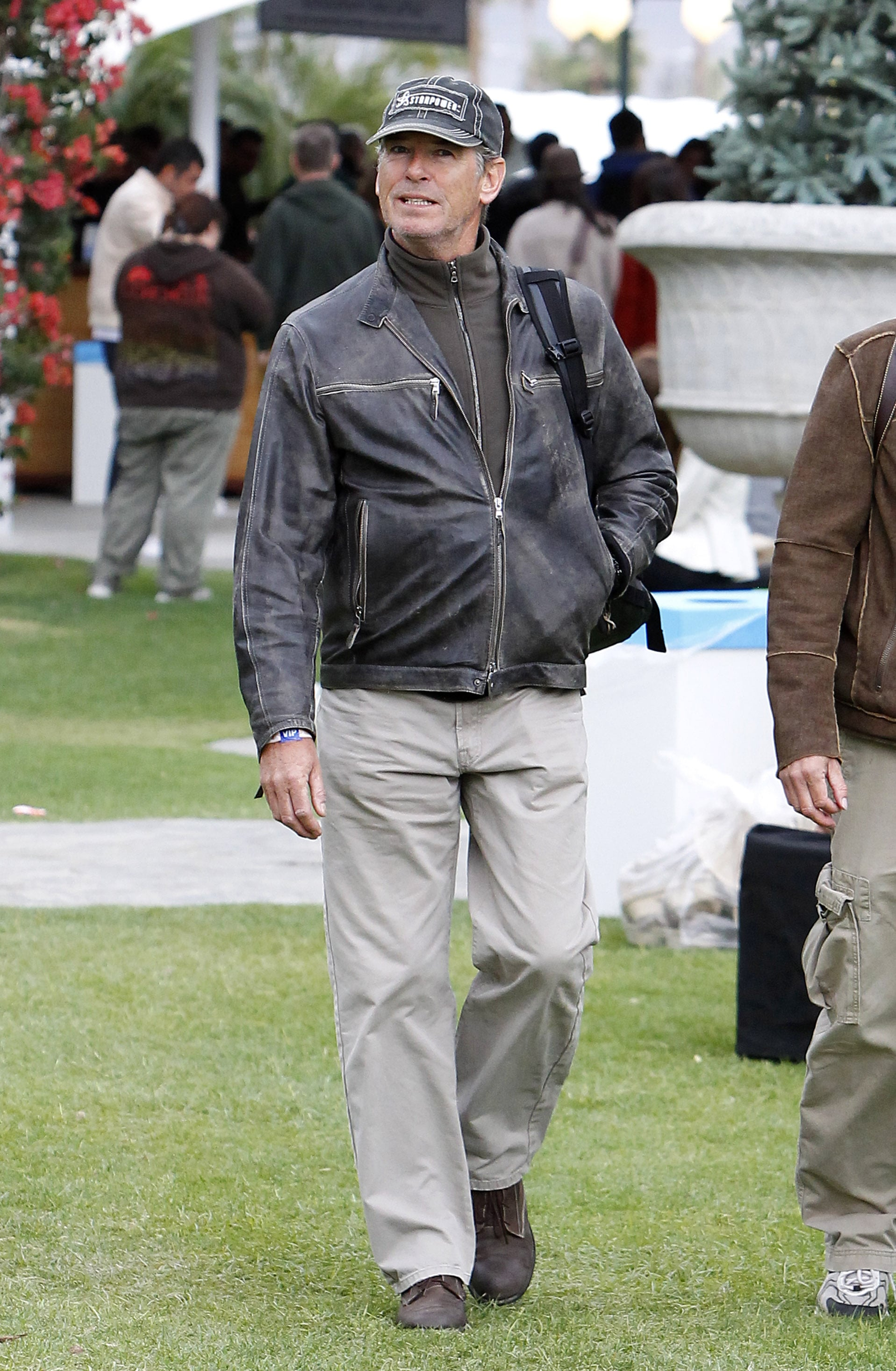 Pierce Brosnan carried a backpack on the first day of Coachella. He arrived early and hung out in the VIP section Friday.