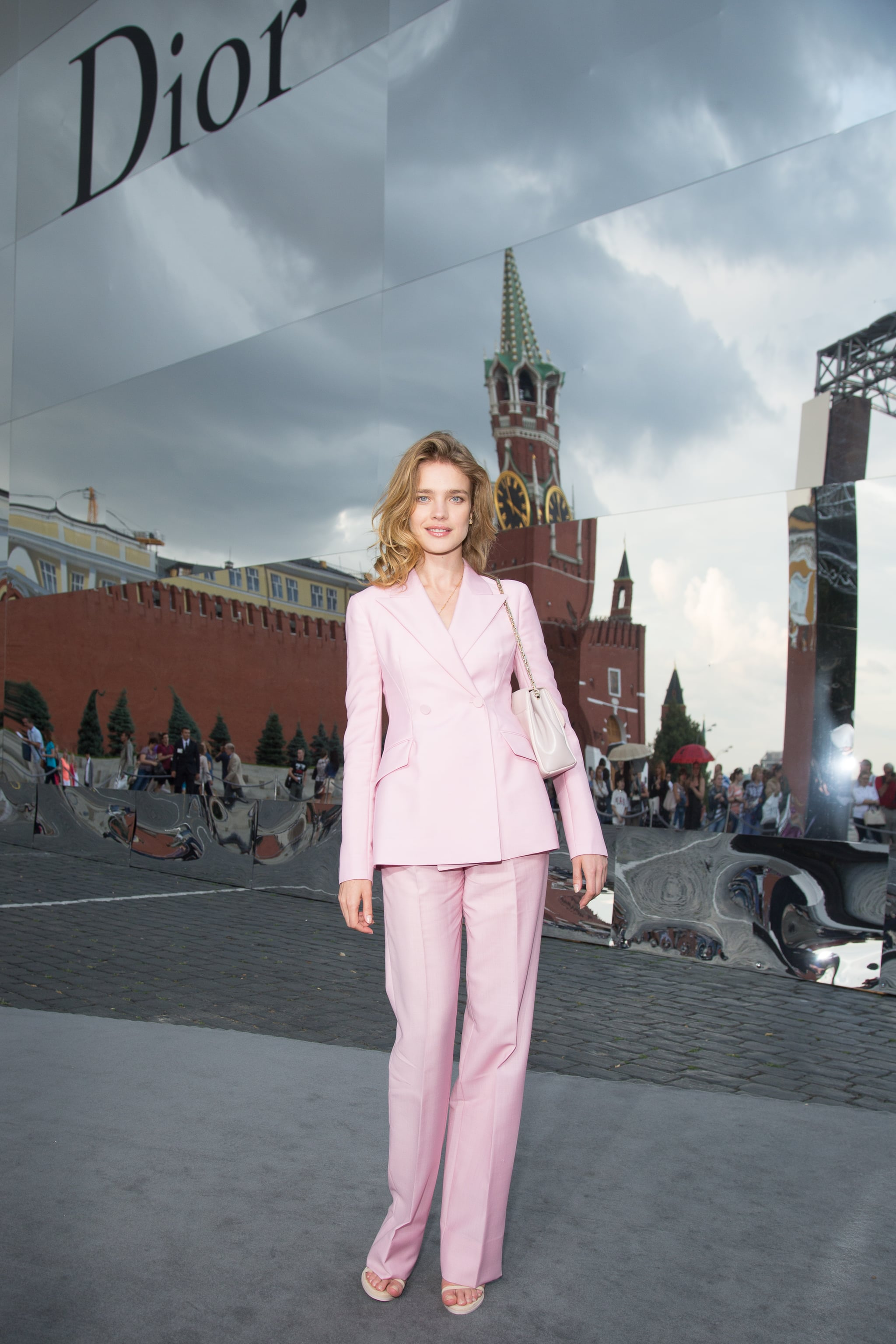The pretty in pink model, Natalia Vodianova, suited up for Christian Dior's Moscow runway show.