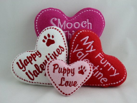 Witty phrases make these conversation heart plush dog toys fun for you and your canine companion.