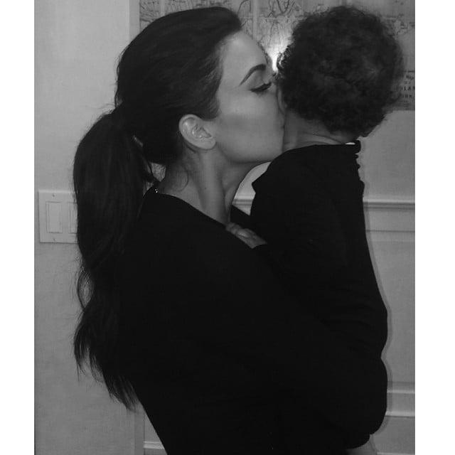 Kim Kardashian planted a kiss on little North West. Source: Instagram user kimkardashian
