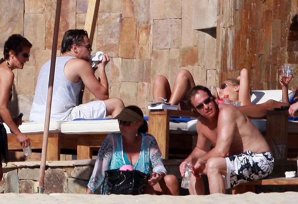 Leonardo DiCaprio, Bar Refaeli, and their pals relaxed poolside in the Maya Riviera in January 2010.