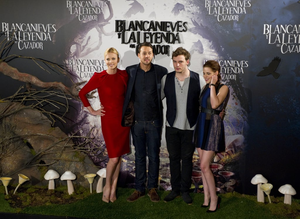 Charlize Theron, Rupert Sanders, Sam Claflin, and Kristen Stewart were arm-in-arm at the Snow White and the Huntsman photocall in Madrid.