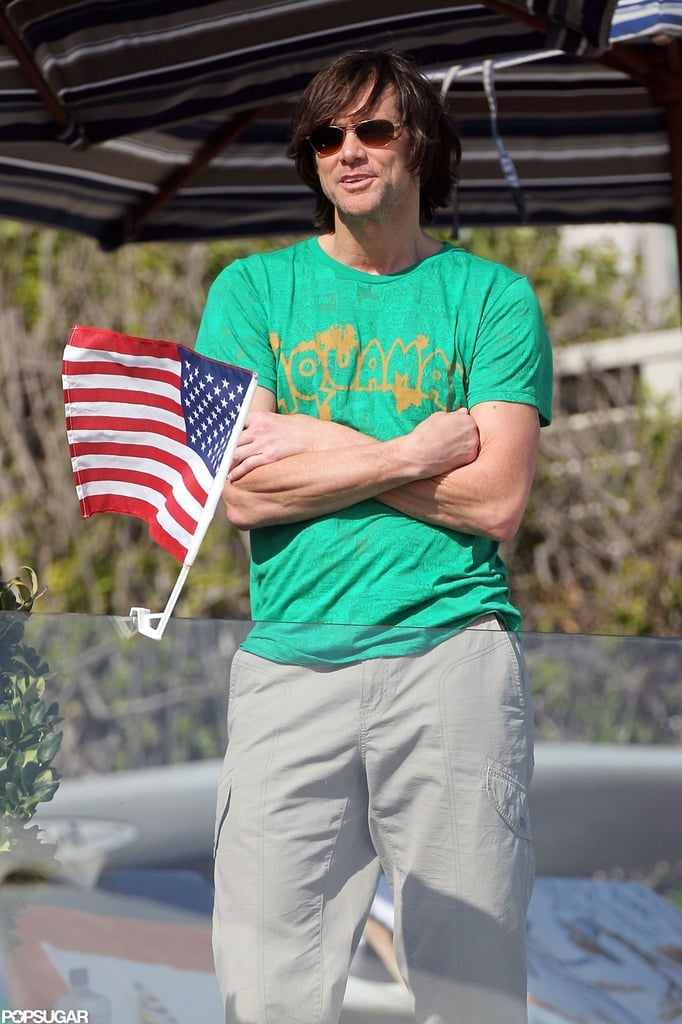 Jim Carrey waved an American flag during a 2010 party in Malibu, CA, for Fourth of July.