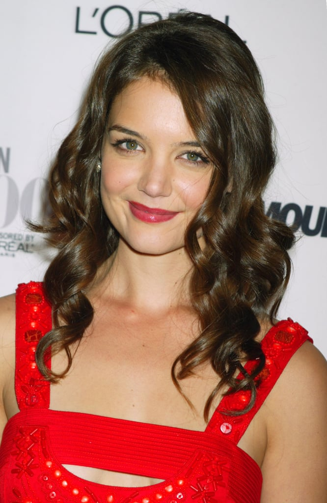 It's rare to see Katie in anything other than neutral makeup tones. At the Glamour Women of the Year Awards in 2004, however, she pulled out a classic red lip (and matching dress).