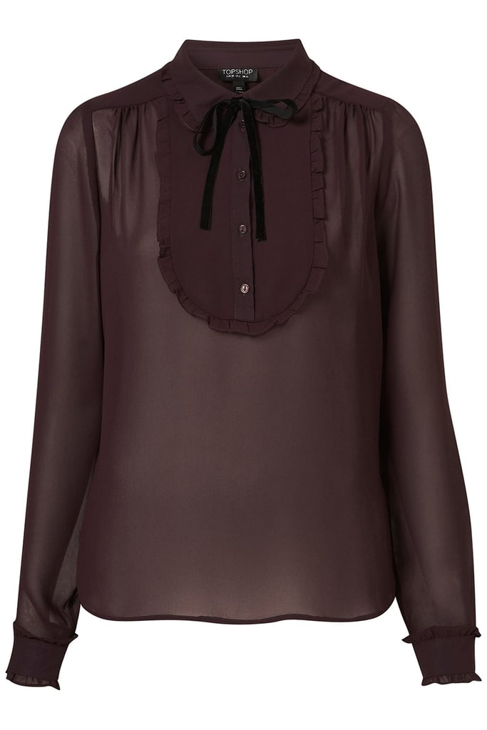 The gorgeous burgundy hue, the subtle sheer effect, and the hint of girlieness are just three of the reasons why I love this Topshop Longsleeve Bib Tie Blouse, ($72). More that that, I can totally see myself wearing this with my lace-up booties, cuffed skinny jeans, and a pair of gold stud earrings — see! I've already planned my outfit. — Marisa Tom, associate editor