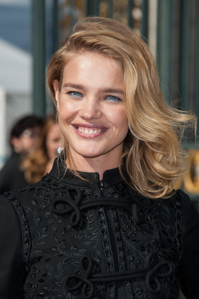 A closeup on the intricate detailing of Natalia Vodianova's black dress.