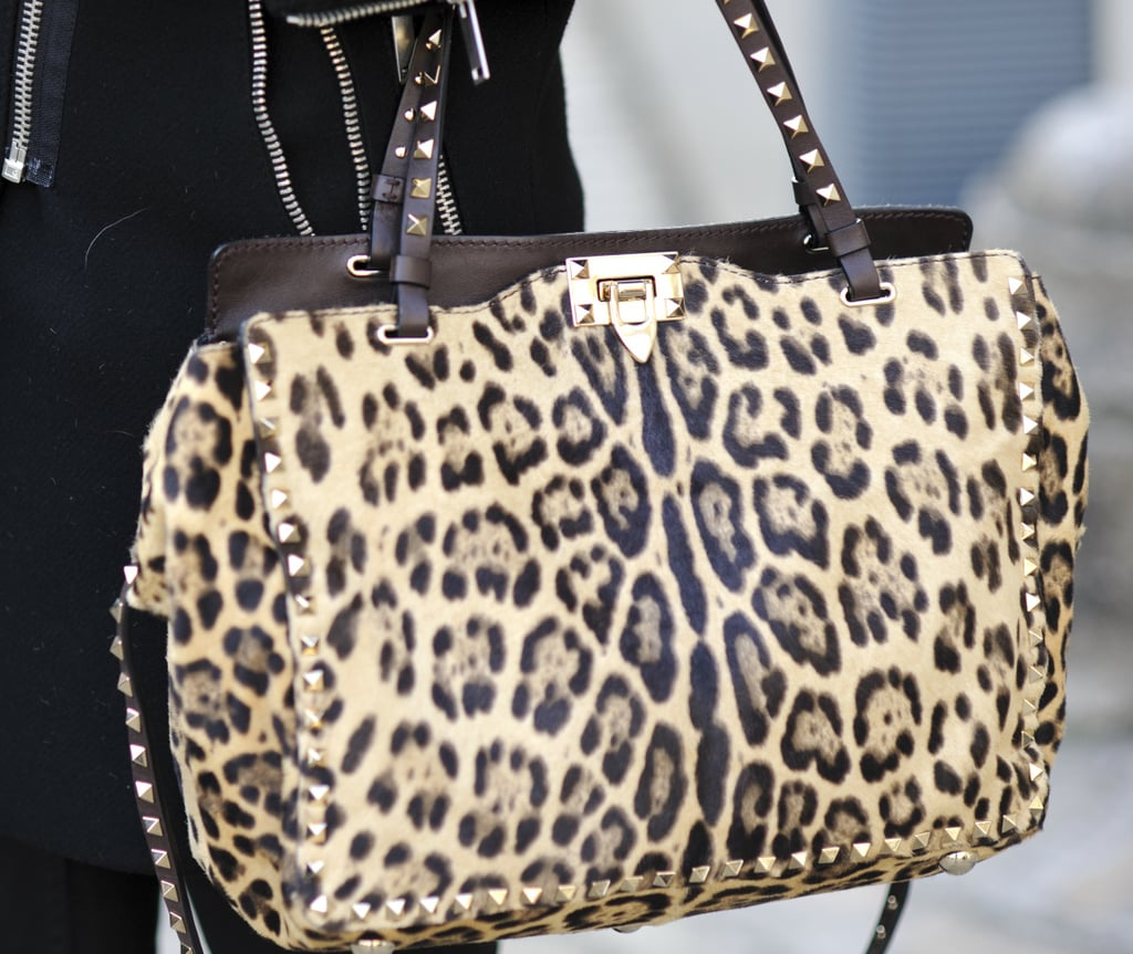 Valentino's studded leopard-print bag popped against a sleek black coat.