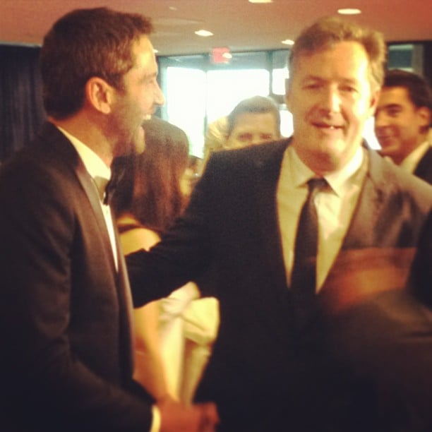 """Gerard Butler laughed with his """"man date"""" Piers Morgan on the White House Correspondents' Dinner red carpet."""