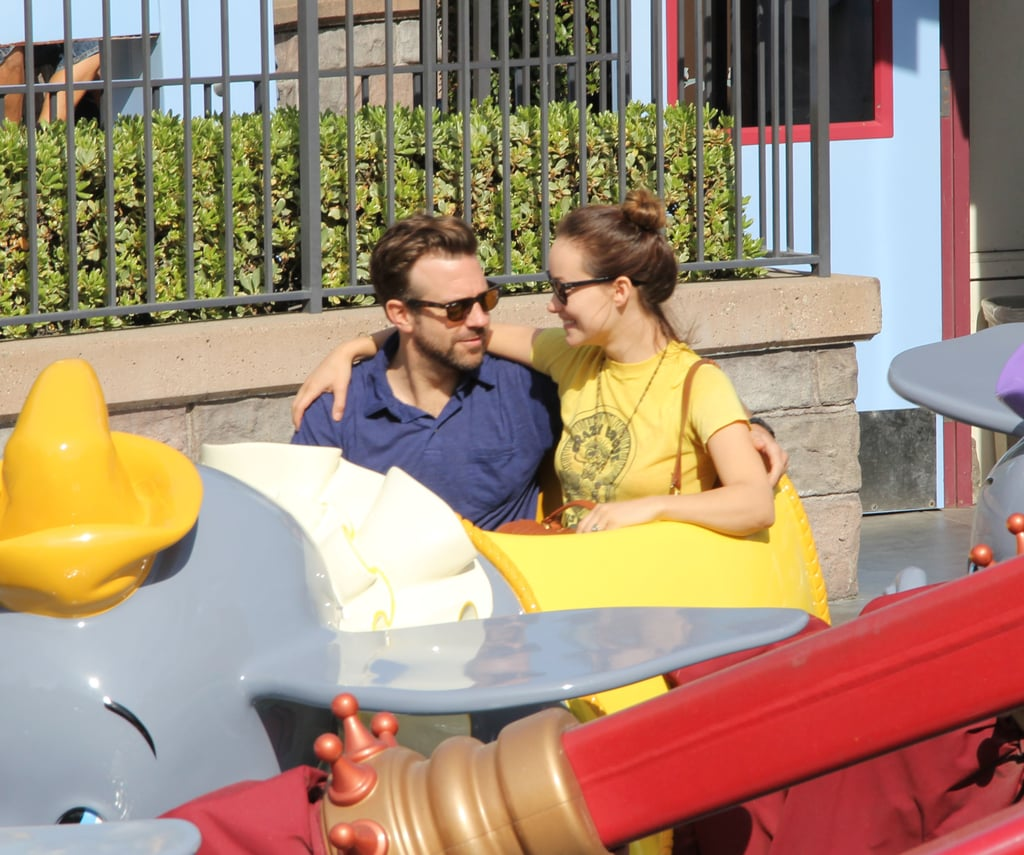 Olivia and Jason Cuddle Up on a Kiddie Ride at Disneyland