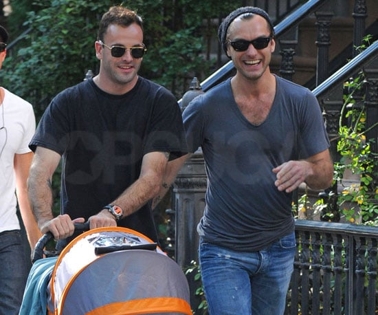 Slide Photo of Jude Law Walking in NYC With Friend Pushing a Baby Stroller