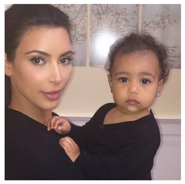 """Kim and North did their best """"paparazzi"""" faces for the camera in this November 2014 snap."""