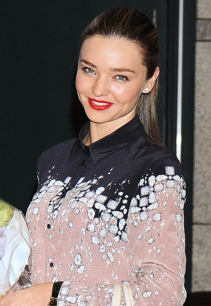 Have straight strands? Pull your hair back into a sleek ponytail for a polished yet easy look like Miranda Kerr.