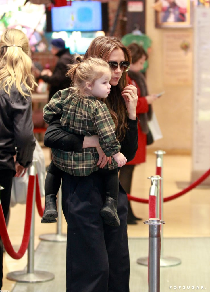 Victoria Takes Harper Toy Shopping Following NYFW