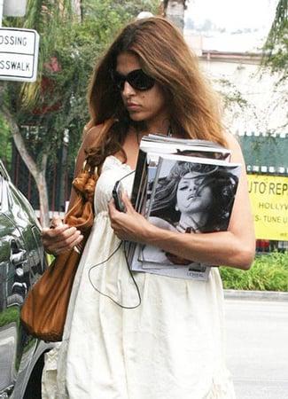 Eva Mendes Keeps Her Headphones in and Her Hands Free