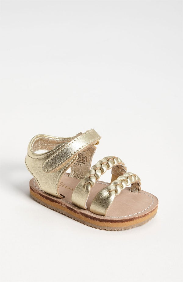 Tiny toes will stay put thanks to the velcro strap on Cole Haan's gold Mini Jamie sandal ($38).