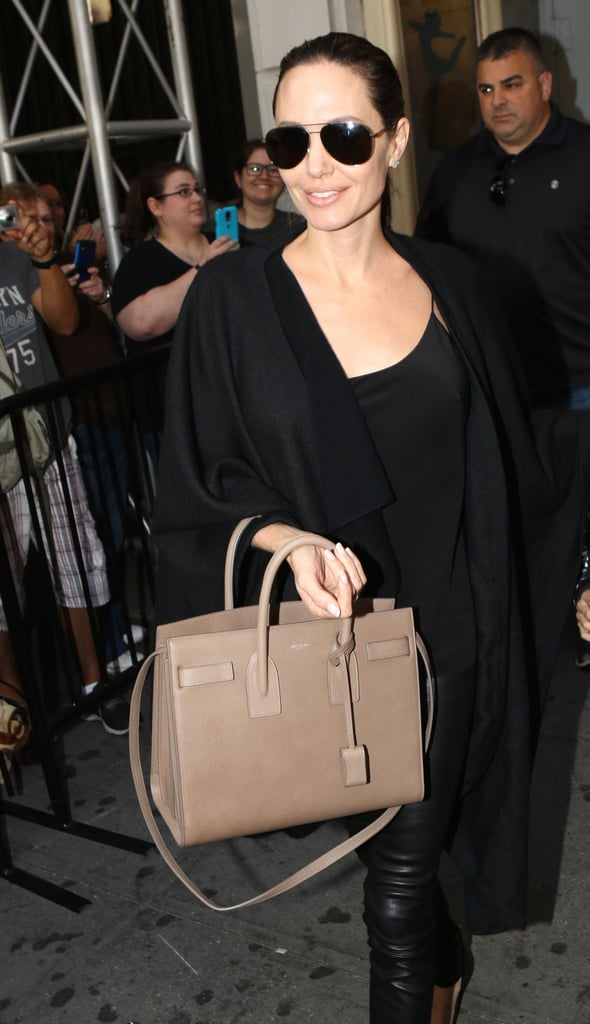 She Also Wore Aviator Shades and Carried a Beige Structured Bag