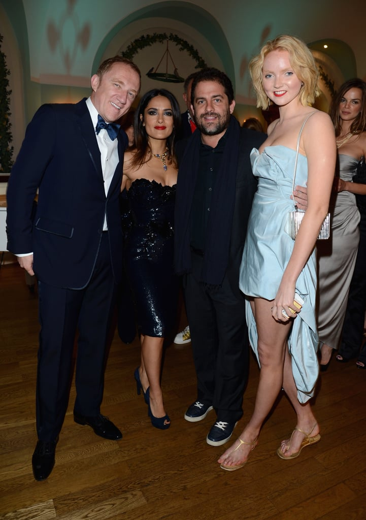 Salma Hayek and her husband Francois-Henri Pinault posed with friends at Vanity Fair and Gucci's party.