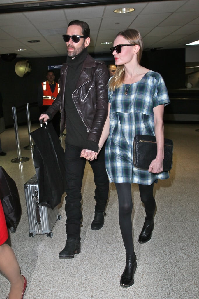 Kate Bosworth touched down at LAX looking sweet and chic in this plaid smock dress by Topshop ($76), black ankle boots, and a pebbled leather clutch.