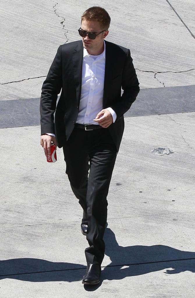 Robert Pattinson wore a suit and sunglasses on the set of Maps to the Stars in LA.