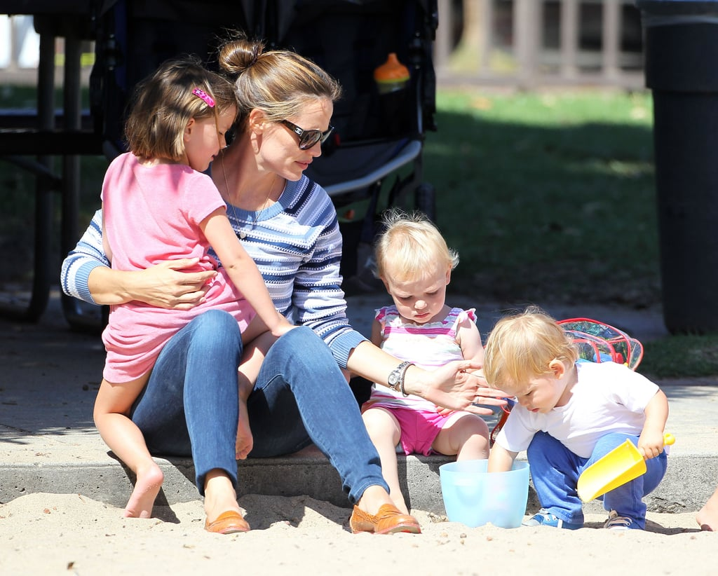 Jennifer Garner held onto Seraphina while Samuel played in the sand.