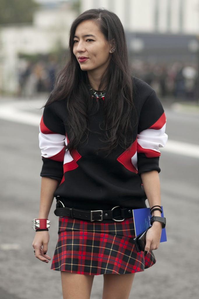A sweatshirt says sporty, a plaid mini says punk.