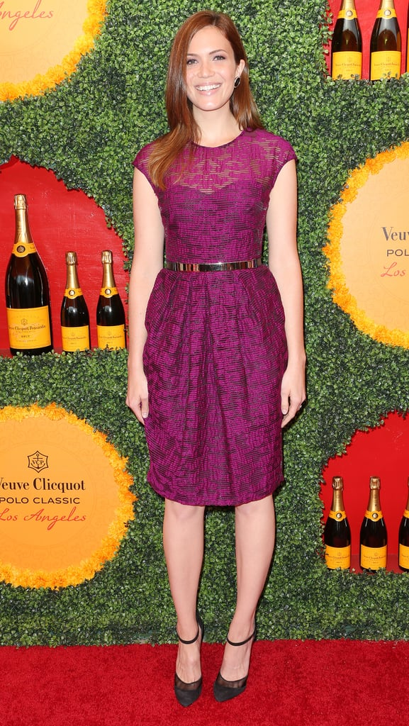 Mandy Moore was the picture of pretty in a textured purple Lela Rose number and ankle-strap Christian Louboutin pumps.