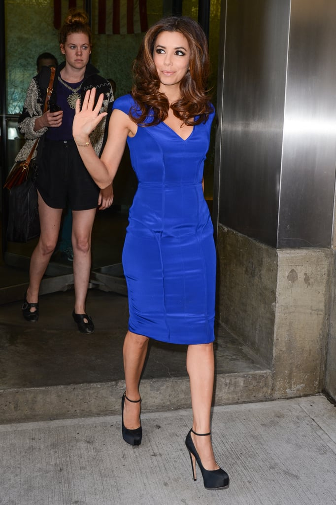 Wearing a brilliant blue cap-sleeved sheath, Eva waved to adoring fans during an NYC visit in 2012.